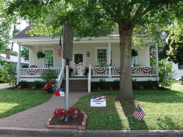 "In keeping with our patriotic theme, residents of town got into the spirit and decorated their yards - this house was the ""Most Patriotic!""  Thank you to everyone who decorated!"